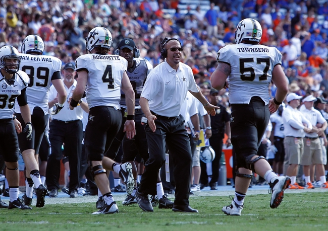 Nov 9, 2013; Gainesville, FL, USA; Vanderbilt Commodores head coach James Franklin congratulates quarterback Patton Robinette (4) and offensive linesman Joe Townsend (57) after they scored against the Florida Gators during the second half at Ben Hill Griffin Stadium. Vanderbilt Commodores defeated the Florida Gators 34-17. Mandatory Credit: Kim Klement-USA TODAY Sports