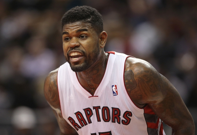 Nov 22, 2013; Toronto, Ontario, CAN; Toronto Raptors forward Amir Johnson (15) yells out instructions during their game against the Washington Wizards at Air Canada Centre. The Raptors beat the Wizards 96-88. Mandatory Credit: Tom Szczerbowski-USA TODAY Sports