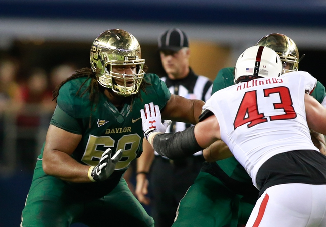 Nov 16, 2013; Arlington, TX, USA; Baylor Bears guard Cyril Richardson (68) blocks on the line of scrimmage during the game against the Texas Tech Red Raiders at AT&T Stadium. Baylor beat Texas Tech 63-34. Mandatory Credit: Tim Heitman-USA TODAY Sports