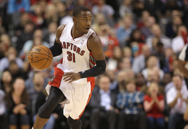 Nov 22, 2013; Toronto, Ontario, CAN; Toronto Raptors guard Terrence Ross (31) dribbles the ball against the Washington Wizards at Air Canada Centre. The Raptors beat the Wizards 96-88. Mandatory Credit: Tom Szczerbowski-USA TODAY Sports