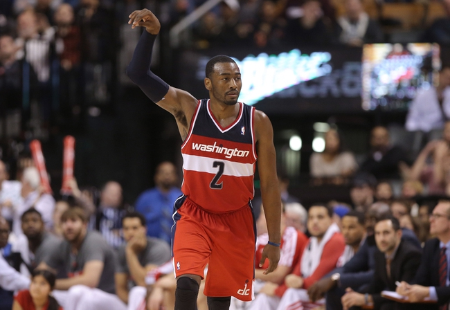 Nov 22, 2013; Toronto, Ontario, CAN; Washington Wizards point guard John Wall (2) reacts after hitting a three-point shot against the Toronto Raptors at Air Canada Centre. The Raptors beat the Wizards 96-88. Mandatory Credit: Tom Szczerbowski-USA TODAY Sports