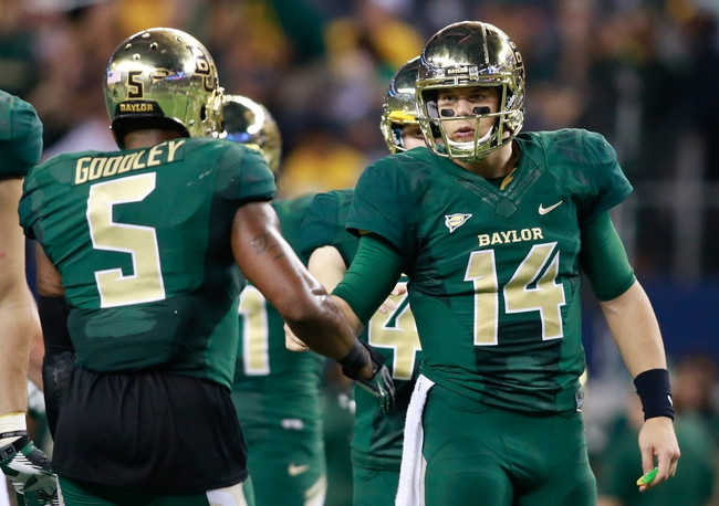Nov 16, 2013; Arlington, TX, USA; Baylor Bears quarterback Bryce Petty (14) congratulates wide receiver Antwan Goodley (5) during the game against the Texas Tech Red Raiders at AT&T Stadium. Baylor beat Texas Tech 63-34. Mandatory Credit: Tim Heitman-USA TODAY Sports
