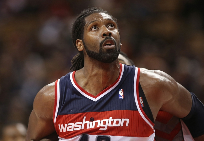 Nov 22, 2013; Toronto, Ontario, CAN; Washington Wizards forward Nene (42) against the Toronto Raptors at Air Canada Centre. The Raptors beat the Wizards 96-88. Mandatory Credit: Tom Szczerbowski-USA TODAY Sports