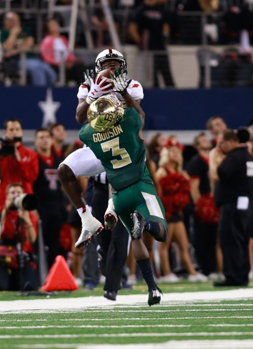 Nov 16, 2013; Arlington, TX, USA; Texas Tech Red Raiders wide receiver Eric Ward (18) catches a pass while defended by Baylor Bears cornerback Demetri Goodson (3) at AT&T Stadium. Baylor beat Texas Tech 63-34. Mandatory Credit: Tim Heitman-USA TODAY Sports