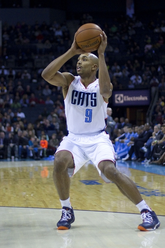 Nov 27, 2013; Charlotte, NC, USA; Charlotte Bobcats shooting guard Gerald Henderson (9) shoots the ball during the first quarter against the Indiana Pacers at Time Warner Cable Arena. Mandatory Credit: Joshua S. Kelly-USA TODAY Sports