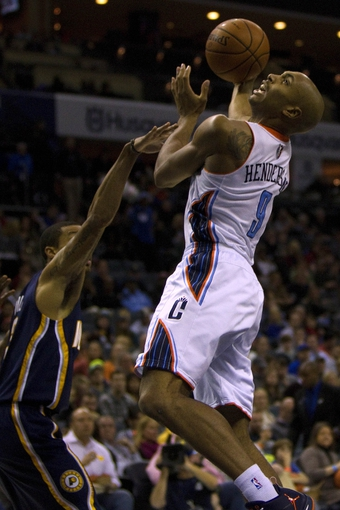 Nov 27, 2013; Charlotte, NC, USA; Charlotte Bobcats shooting guard Gerald Henderson (9) goes in for the layup during the second quarter against the Indiana Pacers at Time Warner Cable Arena. Mandatory Credit: Joshua S. Kelly-USA TODAY Sports