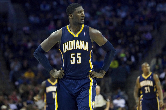 Nov 27, 2013; Charlotte, NC, USA; Indiana Pacers center Roy Hibbert (55) reacts during the second quarter against the Charlotte Bobcats at Time Warner Cable Arena. Mandatory Credit: Joshua S. Kelly-USA TODAY Sports