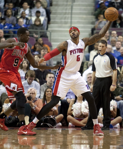 Nov 27, 2013; Auburn Hills, MI, USA; Detroit Pistons small forward Josh Smith (6) grabs the ball as he is defended by Chicago Bulls small forward Luol Deng (9) during the second quarter at The Palace of Auburn Hills. Mandatory Credit: Raj Mehta-USA TODAY Sports