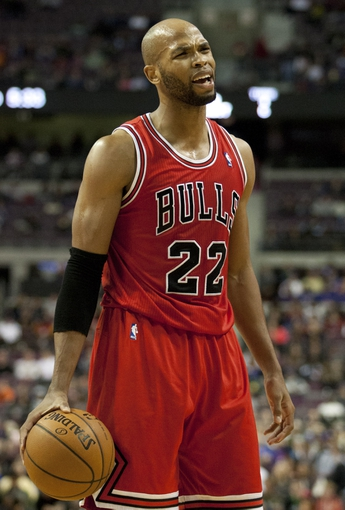 Nov 27, 2013; Auburn Hills, MI, USA; Chicago Bulls power forward Taj Gibson (22) reacts after a call by the referee during the second quarter against the Detroit Pistons at The Palace of Auburn Hills. Mandatory Credit: Raj Mehta-USA TODAY Sports