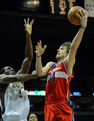 Nov 27, 2013; Milwaukee, WI, USA;  Washington Wizards forward Jan Vesely (24) takes a shot against Milwaukee Bucks forward Ekpe Udoh (5) in the second quarter at BMO Harris Bradley Center. Mandatory Credit: Benny Sieu-USA TODAY Sports