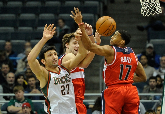 Nov 27, 2013; Milwaukee, WI, USA;   Milwaukee Bucks center Zaza Pachulia (27) and Washington Wizards guard Garrett Temple (17) battle for a rebound in the second quarter at BMO Harris Bradley Center. Mandatory Credit: Benny Sieu-USA TODAY Sports