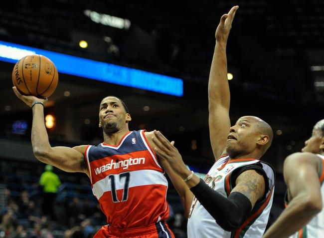 Nov 27, 2013; Milwaukee, WI, USA;  Washington Wizards guard Garrett Temple (17) takes a shot against Milwaukee Bucks forward Caron Butler (3) in the second quarter at BMO Harris Bradley Center. Mandatory Credit: Benny Sieu-USA TODAY Sports