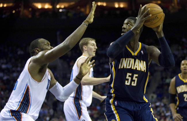 Nov 27, 2013; Charlotte, NC, USA; Indiana Pacers center Roy Hibbert (55) goes in for the layup during the third quarter against the Charlotte Bobcats at Time Warner Cable Arena. Pacers won 99-74. Mandatory Credit: Joshua S. Kelly-USA TODAY Sports