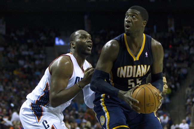 Nov 27, 2013; Charlotte, NC, USA; Indiana Pacers center Roy Hibbert (55) drives to the basket during the third quarter against the Charlotte Bobcats at Time Warner Cable Arena. Pacers won 99-74. Mandatory Credit: Joshua S. Kelly-USA TODAY Sports