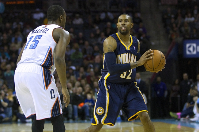 Nov 27, 2013; Charlotte, NC, USA; Indiana Pacers point guard C.J. Watson (32) looks to pass the ball during the fourth quarter against the Charlotte Bobcats at Time Warner Cable Arena. Pacers won 99-74. Mandatory Credit: Joshua S. Kelly-USA TODAY Sports