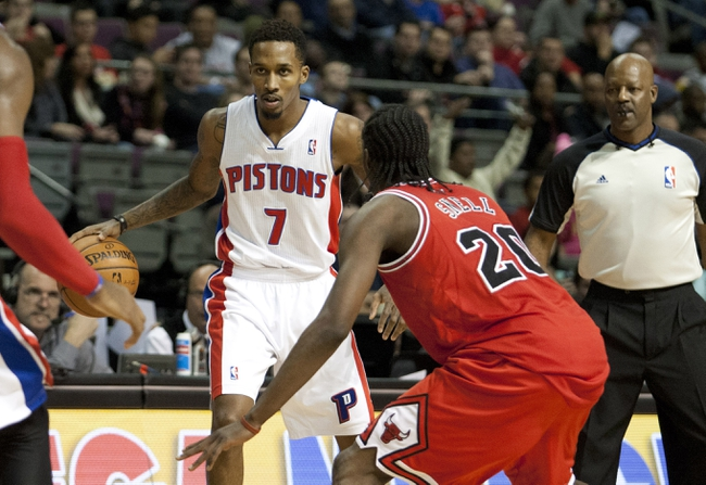 Nov 27, 2013; Auburn Hills, MI, USA; Detroit Pistons point guard Brandon Jennings (7) defended by Chicago Bulls small forward Tony Snell (20) during the third quarter at The Palace of Auburn Hills. Bulls beat the Pistons 99-79. Mandatory Credit: Raj Mehta-USA TODAY Sports