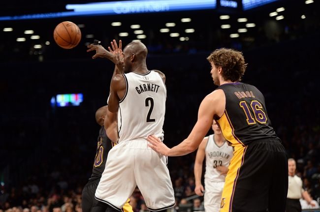 Nov 27, 2013; Brooklyn, NY, USA; Brooklyn Nets power forward Kevin Garnett (2) makes a pass against the Los Angeles Lakers during the second half at Barclays Center. The Lakers won 99-94. Mandatory Credit: Joe Camporeale-USA TODAY Sports