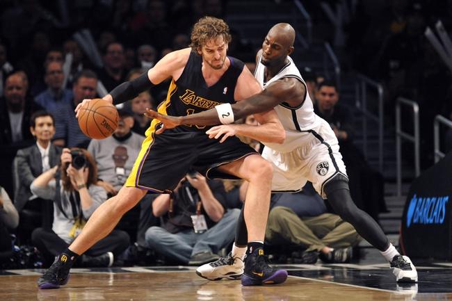 Nov 27, 2013; Brooklyn, NY, USA; Brooklyn Nets power forward Kevin Garnett (2) guards Los Angeles Lakers center Pau Gasol (16) during the second half at Barclays Center. The Lakers won 99-94. Mandatory Credit: Joe Camporeale-USA TODAY Sports