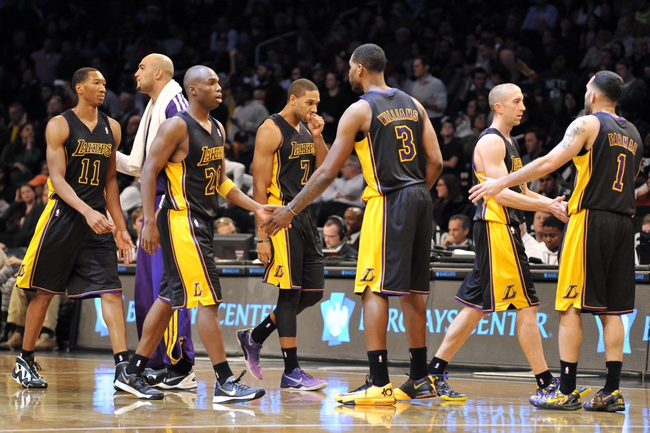 Nov 27, 2013; Brooklyn, NY, USA; The Los Angeles Lakers celebrate against the Brooklyn Nets during the second half at Barclays Center. The Lakers won 99-94. Mandatory Credit: Joe Camporeale-USA TODAY Sports