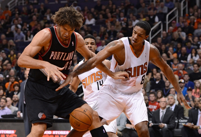 Nov 27, 2013; Phoenix, AZ, USA; Portland Trail Blazers center Robin Lopez (42) and Phoenix Suns forward Channing Frye (8) watch the ball in the first half at US Airways Center. Mandatory Credit: Jennifer Stewart-USA TODAY Sports