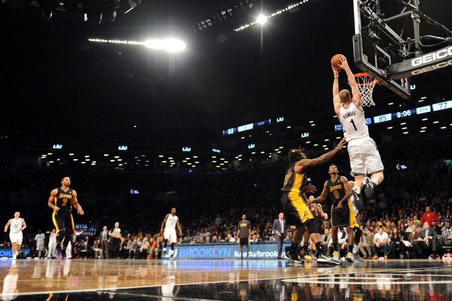 Nov 27, 2013; Brooklyn, NY, USA; Brooklyn Nets power forward Mason Plumlee (1) dunks the ball against the Los Angeles Lakers during the second half at Barclays Center. The Lakers won 99-94. Mandatory Credit: Joe Camporeale-USA TODAY Sports