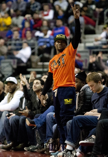 Nov 27, 2013; Auburn Hills, MI, USA; American professional boxer Floyd Mayweather Jr. waves to the crowd during the fourth quarter of the game between the Detroit Pistons and Chicago Bulls at The Palace of Auburn Hills. Bulls beat the Pistons 99-79. Mandatory Credit: Raj Mehta-USA TODAY Sports