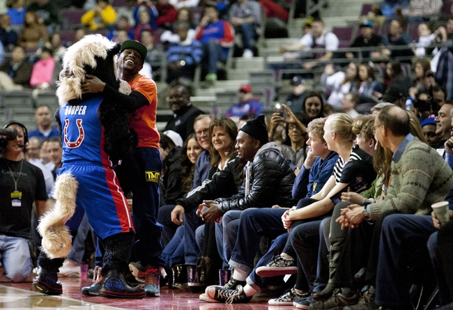 Nov 27, 2013; Auburn Hills, MI, USA; American professional boxer Floyd Mayweather Jr. goofs around with Detroit Pistons mascot Hooper during the fourth quarter against the Chicago Bulls at The Palace of Auburn Hills. Bulls beat the Pistons 99-79. Mandatory Credit: Raj Mehta-USA TODAY Sports