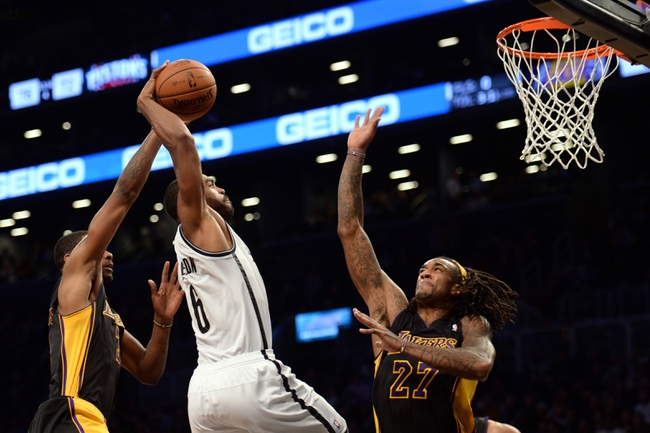 Nov 27, 2013; Brooklyn, NY, USA; Brooklyn Nets shooting guard Alan Anderson (6) attempts a dunk against the Los Angeles Lakers during the second half at Barclays Center. The Lakers won 99-94. Mandatory Credit: Joe Camporeale-USA TODAY Sports