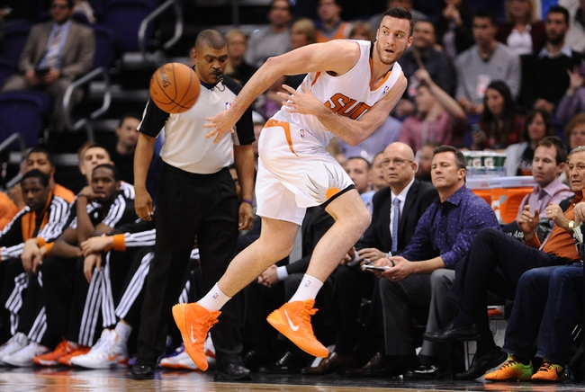 Nov 27, 2013; Phoenix, AZ, USA; Phoenix Suns forward Miles Plumlee (22) saves the ball from going out of bounds against the Portland Trail Blazers in the first half at US Airways Center. Mandatory Credit: Jennifer Stewart-USA TODAY Sports