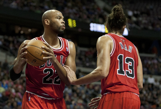 Nov 27, 2013; Auburn Hills, MI, USA; Chicago Bulls power forward Taj Gibson (22) and center Joakim Noah (13) secure a rebound during the fourth quarter against the Detroit Pistons at The Palace of Auburn Hills. Bulls beat the Pistons 99-79. Mandatory Credit: Raj Mehta-USA TODAY Sports