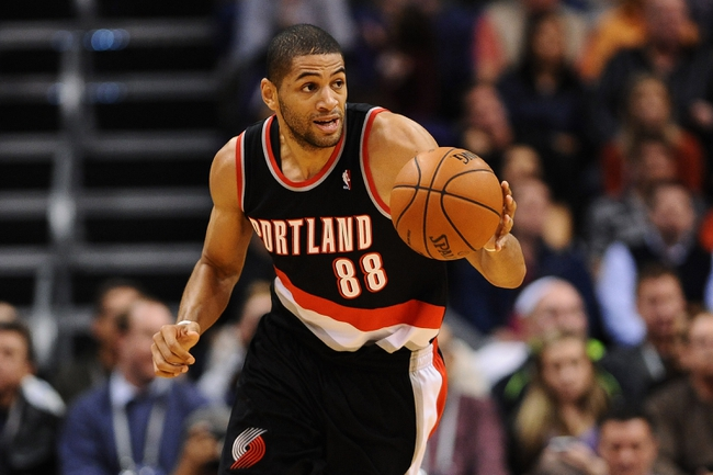 Nov 27, 2013; Phoenix, AZ, USA; Portland Trail Blazers forward Nicolas Batum (88) dribbles the ball up the court against the Phoenix Suns in the first half at US Airways Center. Mandatory Credit: Jennifer Stewart-USA TODAY Sports