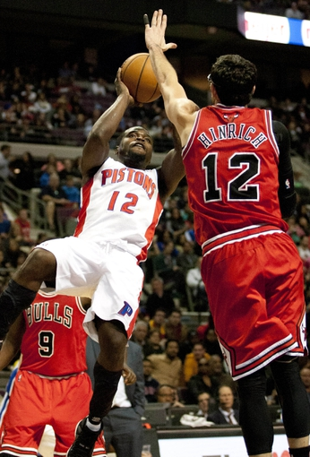 Nov 27, 2013; Auburn Hills, MI, USA; Detroit Pistons point guard Will Bynum (12) takes a shot over Chicago Bulls shooting guard Kirk Hinrich (12) during the fourth quarter at The Palace of Auburn Hills. Bulls beat the Pistons 99-79. Mandatory Credit: Raj Mehta-USA TODAY Sports