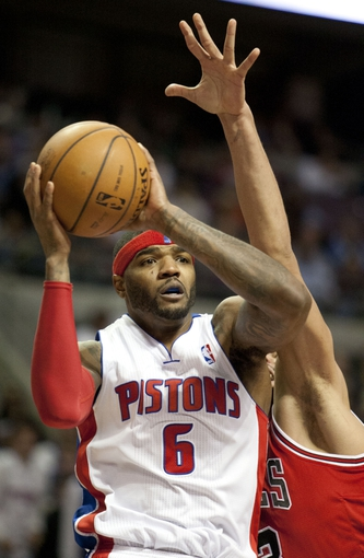 Nov 27, 2013; Auburn Hills, MI, USA; Detroit Pistons small forward Josh Smith (6) defended by Chicago Bulls center Joakim Noah (13) during the fourth quarter at The Palace of Auburn Hills. Bulls beat the Pistons 99-79. Mandatory Credit: Raj Mehta-USA TODAY Sports