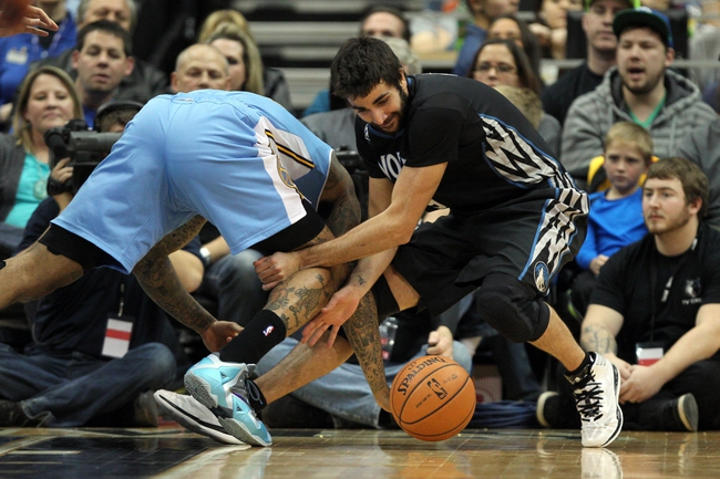 Nov 27, 2013; Minneapolis, MN, USA; Minnesota Timberwolves guard Ricky Rubio (9) steals the ball from Denver Nuggets forward Wilson Chandler (21) during the third quarter at Target Center. The Nuggets defeated the Timberwolves 117-110. Mandatory Credit: Brace Hemmelgarn-USA TODAY Sports