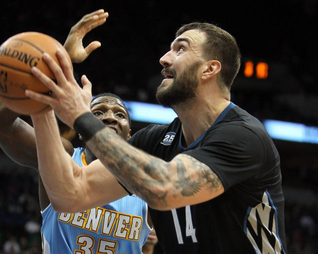 Nov 27, 2013; Minneapolis, MN, USA; Minnesota Timberwolves center Nikola Pekovic (14) shoots over Denver Nuggets forward Kenneth Faried (35) during the third quarter at Target Center. The Nuggets defeated the Timberwolves 117-110. Mandatory Credit: Brace Hemmelgarn-USA TODAY Sports