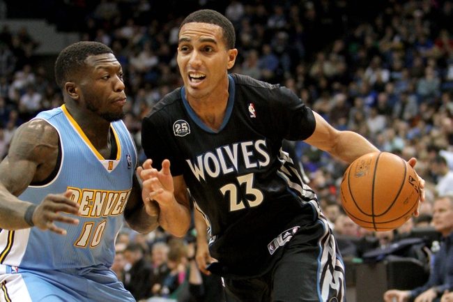 Nov 27, 2013; Minneapolis, MN, USA; Minnesota Timberwolves guard Kevin Martin (23) drives past Denver Nuggets guard Nate Robinson (10) during the third quarter  at Target Center. The Nuggets defeated the Timberwolves 117-110. Mandatory Credit: Brace Hemmelgarn-USA TODAY Sports