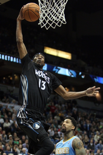 Nov 27, 2013; Minneapolis, MN, USA; Minnesota Timberwolves forward Corey Brewer (13) dunks during the fourth quarter against the Denver Nuggets at Target Center. The Nuggets defeated the Timberwolves 117-110. Mandatory Credit: Brace Hemmelgarn-USA TODAY Sports