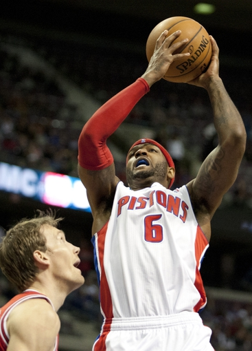 Nov 27, 2013; Auburn Hills, MI, USA; Detroit Pistons small forward Josh Smith (6) attempts a shot over Chicago Bulls small forward Mike Dunleavy (34) during the fourth quarter at The Palace of Auburn Hills. Bulls beat the Pistons 99-79. Mandatory Credit: Raj Mehta-USA TODAY Sports