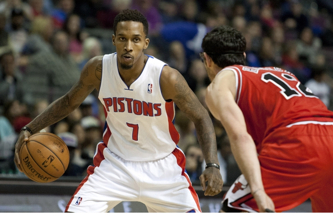 Nov 27, 2013; Auburn Hills, MI, USA; Detroit Pistons point guard Brandon Jennings (7) gets defended by Chicago Bulls shooting guard Kirk Hinrich (12) during the fourth quarter at The Palace of Auburn Hills. Bulls beat the Pistons 99-79. Mandatory Credit: Raj Mehta-USA TODAY Sports