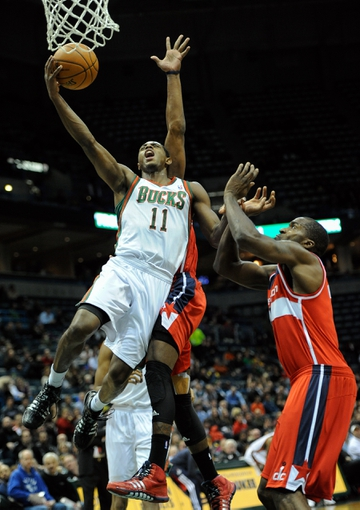 Nov 27, 2013; Milwaukee, WI, USA;   Milwaukee Bucks guard Brandon Knight (11) takes a shot against Washington Wizards forward Martell Webster (9) in the third quarter at BMO Harris Bradley Center. Mandatory Credit: Benny Sieu-USA TODAY Sports