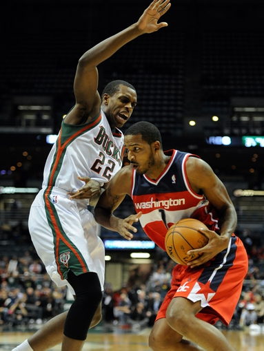 Nov 27, 2013; Milwaukee, WI, USA;   Washington Wizards forward Trevor Ariza (1) drives for the basket against Milwaukee Bucks forward Khris Middleton (22) in the forth quarter at BMO Harris Bradley Center. Mandatory Credit: Benny Sieu-USA TODAY Sports