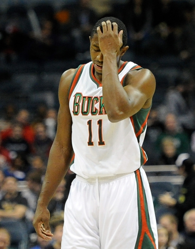 Nov 27, 2013; Milwaukee, WI, USA;  Milwaukee Bucks guard Brandon Knight (11) reacts after a turnover in the forth quarter during the game against the Washington Wizards at BMO Harris Bradley Center. Mandatory Credit: Benny Sieu-USA TODAY Sports