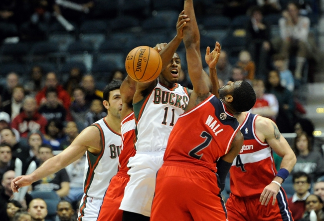 Nov 27, 2013; Milwaukee, WI, USA;   Milwaukee Bucks guard Brandon Knight (11) turns the ball over while under pressure from Washington Wizards guard John Wall (2) in the forth quarter at BMO Harris Bradley Center. Mandatory Credit: Benny Sieu-USA TODAY Sports