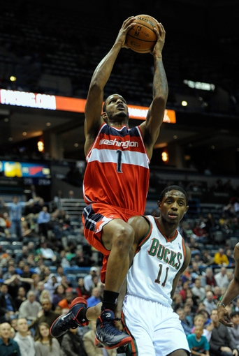 Nov 27, 2013; Milwaukee, WI, USA;   Washington Wizards forward Trevor Ariza (1) takes a shot against Milwaukee Bucks guard Brandon Knight (11) in the forth quarter at BMO Harris Bradley Center. Mandatory Credit: Benny Sieu-USA TODAY Sports