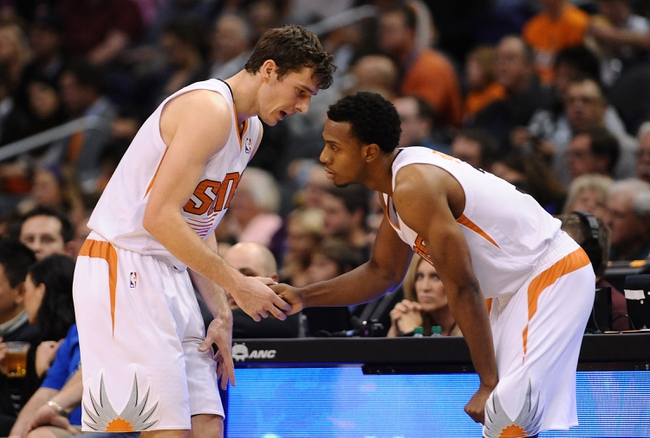 Nov 27, 2013; Phoenix, AZ, USA; Phoenix Suns guard Goran Dragic (1) talks with guard Ish Smith (3) during the second half against the Portland Trail Blazers at US Airways Center. The Suns won 120 -106. Mandatory Credit: Jennifer Stewart-USA TODAY Sports