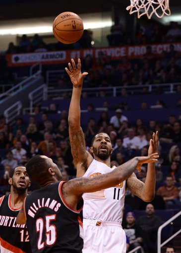 Nov 27, 2013; Phoenix, AZ, USA; Phoenix Suns forward Markieff Morris (11) shoots the ball in front of Portland Trail Blazers guard Mo Williams (25) in the second half at US Airways Center. The Suns won 120-106. Mandatory Credit: Jennifer Stewart-USA TODAY Sports