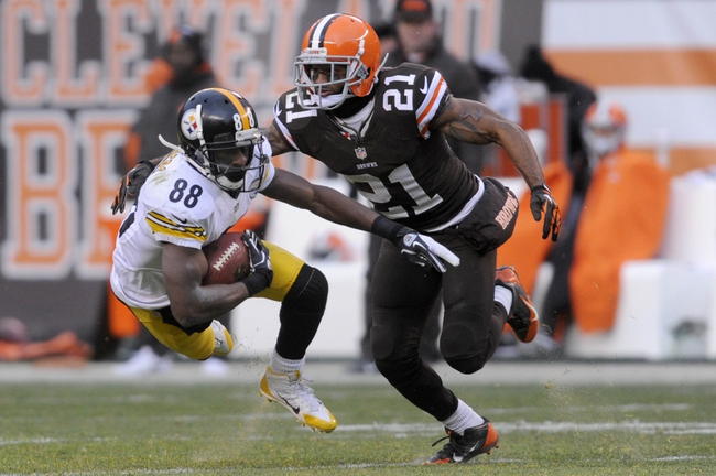 Nov 24, 2013; Cleveland, OH, USA; Cleveland Browns cornerback Chris Owens (21) defends against Pittsburgh Steelers wide receiver Emmanuel Sanders (88) during the fourth quarter at FirstEnergy Stadium. The Steelers beat the Browns 27-11. Mandatory Credit: Ken Blaze-USA TODAY Sports