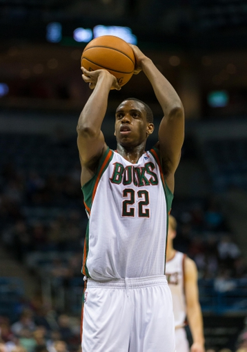 Nov 23, 2013; Milwaukee, WI, USA; Milwaukee Bucks forward Khris Middleton (22) shoots a free throw during the game against the Charlotte Bobcats at BMO Harris Bradley Center.  Charlotte won 96-72.  Mandatory Credit: Jeff Hanisch-USA TODAY Sports
