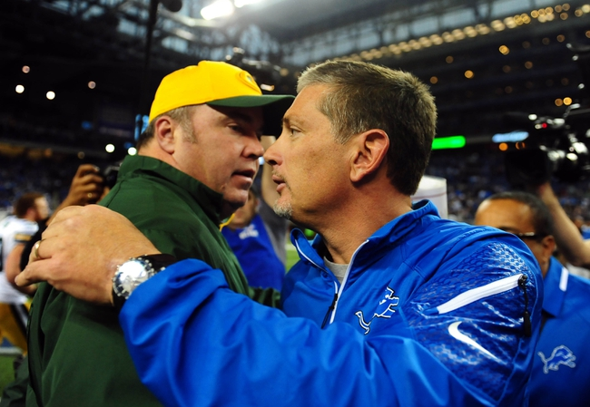 Nov 28, 2013; Detroit, MI, USA; Green Bay Packers head coach Mike McCarthy (left) shakes hands with Detroit Lions head coach Jim Schwartz after a NFL football game on Thanksgiving at Ford Field. Detroit Lions defeated the Green Bay Packers 40-10. Mandatory Credit: Andrew Weber-USA TODAY Sports