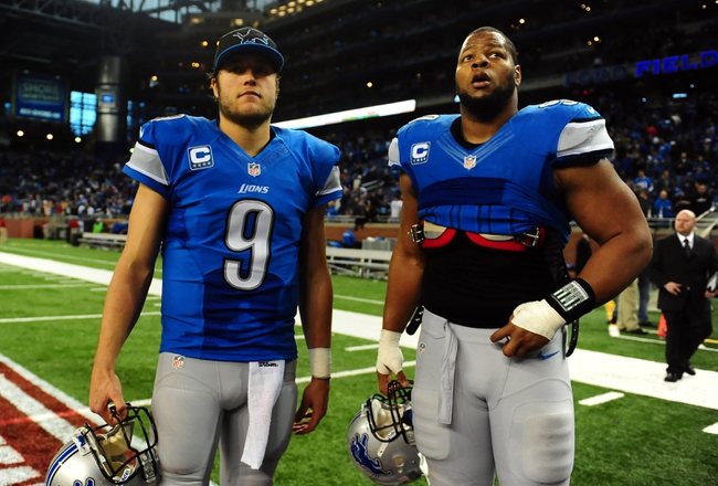 Nov 28, 2013; Detroit, MI, USA; Detroit Lions quarterback Matthew Stafford (9) and defensive tackle Ndamukong Suh (90) after a NFL football game against the Green Bay Packers on Thanksgiving at Ford Field. Detroit Lions defeated the Green Bay Packers 40-10. Mandatory Credit: Andrew Weber-USA TODAY Sports